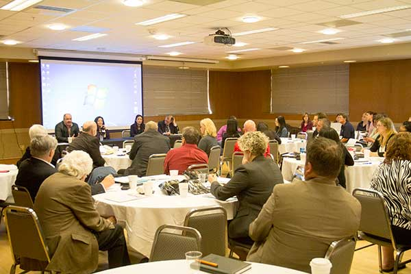 Symposium attendees during the Q and A session with the panel of representatives from Cargill, AbbVie Research and Development, and the Humane Society of the United States.