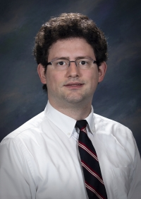 Adam McGinn Programmer Analyst